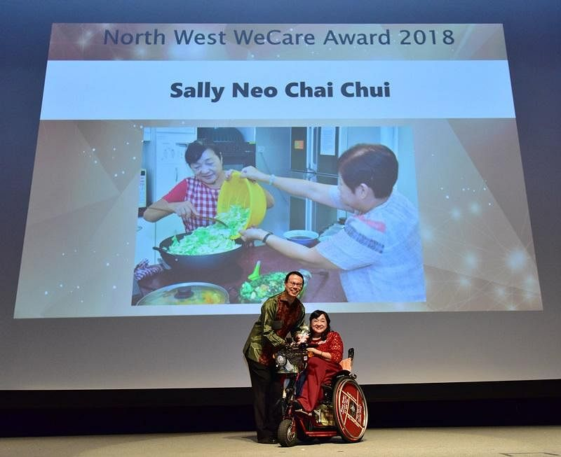 sally_neo_receiving_award_on_stage_Medium.jpg