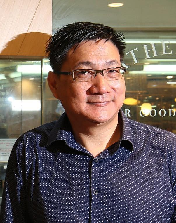 张耀文和其团队研发出全球首台全自动化煮鸡只机器。