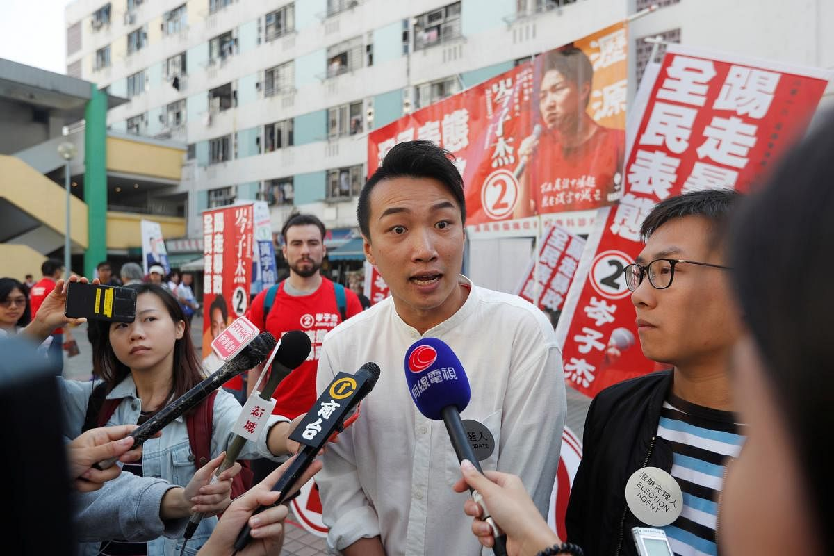 2019-11-24t022638z_873907959_rc2ehd9yhmbw_rtrmadp_3_hongkong-protests-election_Large.jpg
